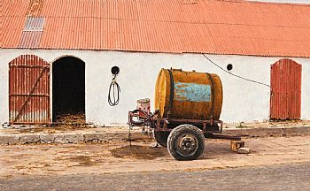 John Doherty, Trailer with Accessories, Farmyard, Dingle Peninsula (1985) at Morgan O'Driscoll Art Auctions